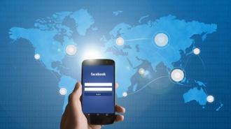 phone_social_media_linking_to_world_map