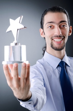 Motivation and Reward - Employee Excited about Recognition Trophy